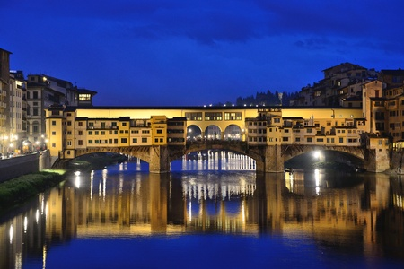 retained: FLORENCE, ITALY - APRIL 27: Ponte Vecchio arch bridge over the Arno River on April 27, 2013 in Florence, Italy. It is the only bridge in Florence, has retained its original appearance since 1345 year