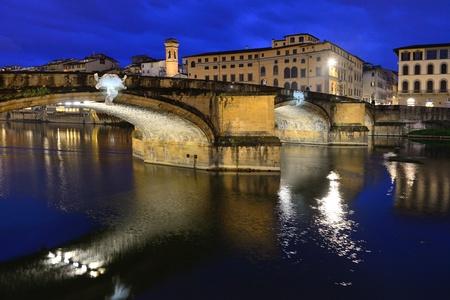 sightseeng: FLORENCE, ITALY - APRIL 27: Ponte Santa Trinita bridge over the Arno River shown on April 27, 2013 in Florence, Italy. The Ponte Santa Trinita is the oldest elliptic arch bridge in the world