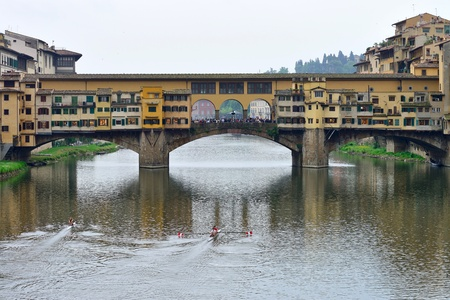 retained: FLORENCE, ITALY - APRIL 27: Ponte Vecchio arch bridge over the Arno River on April 27, 2013 in Florence, Italy. It is the only bridge in Florence, has retained its original appearance since 1345 year.