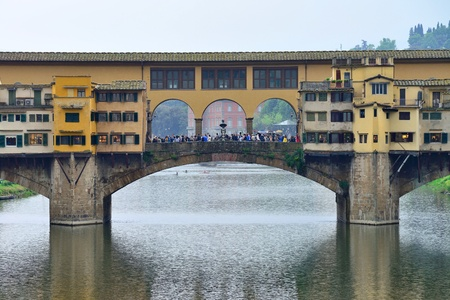 sightseeng: FLORENCE, ITALY - APRIL 27: Ponte Vecchio arch bridge over the Arno River on April 27, 2013 in Florence, Italy. It is the only bridge in Florence, has retained its original appearance since 1345 year.