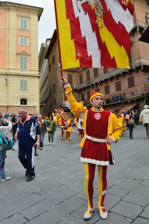 palio: SIENA, ITALY - APRIL 28: The contrada of Valdimontone (Valley of the Ram) parade through the streets of Siena in preparation for the Palio April 28, 2013 in Siena, Italy. Editorial