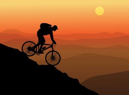 日没の背景を持つ自転車のシルエット