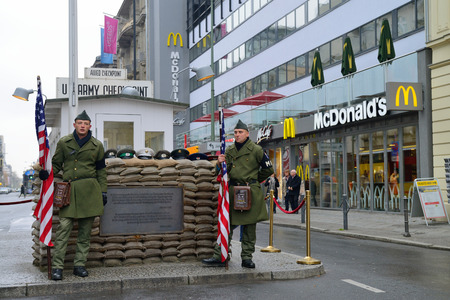 BERLIN - NOVEMBER 23  Former bordercross checkpoint  Point Charlie  in Berlin on November 23, 2013  It s the best-known Berlin Wall crossing point between East and West Berlin during the Cold War