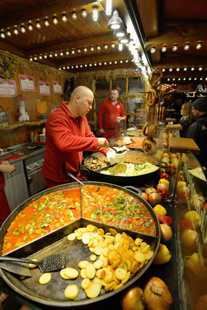 tradespeople: BERLIN - NOVEMBER 23  Unidentified people trades food in annual traditional Christmas fair in Potsdamer Platz  Potsdam Square  on 23 November 2013 in Berlin, Germany
