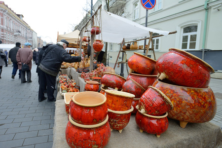 VILNIUS, LITHUANIA - MARCH 7  Unidentified people trades typical lithuanian clay pots in annual traditional crafts fair - Kaziuko fair on Mar 7, 2014 in Vilnius, Lithuania