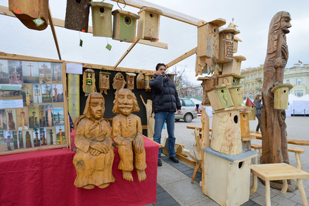 VILNIUS, LITHUANIA - MARCH 7  Unidentified people sell handmade souvenirs from carved wood in annual traditional crafts fair - Kaziuko fair on Mar 7, 2014 in Vilnius, Lithuania