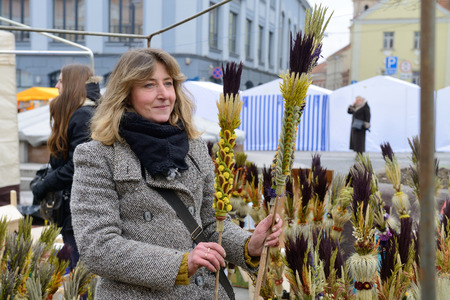 tradespeople: VILNIUS, LITHUANIA - MARCH 7  Unidentified people trades traditional palm bouquets in annual traditional crafts fair - Kaziuko fair on Mar 7, 2014 in Vilnius, Lithuania