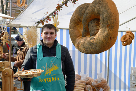 VILNIUS, LITHUANIA - MARCH 8  Unidentified people trade food in annual traditional crafts fair - Kaziuko fair on Mar 8, 2014 in Vilnius, Lithuania