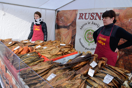 VILNIUS, LITHUANIA - MARCH 8  Unidentified people trade smoked fish in annual traditional crafts fair - Kaziuko fair on Mar 8, 2014 in Vilnius, Lithuania