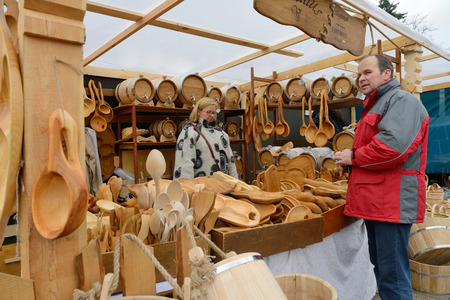 tradespeople: VILNIUS, LITHUANIA - MARCH 7  Unidentified people sell handmade souvenirs from carved wood in annual traditional crafts fair - Kaziuko fair on Mar 7, 2014 in Vilnius, Lithuania Editorial