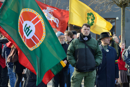 reestablishment: VILNIUS, LITHUANIA - MAR 11  Around one thousand people gathered with flags in a nationalist rally at Rotuses Square on Re-Establishment of Independence Day on March 11, 2014 in Vilnius, Lithuania