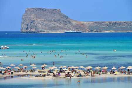 CRETE, GREECE - AUGUST 08  People relaxing at Balos beach in Crete, Greece on 08 August 2014  Balos beach is one of a famous beach in the Crete island