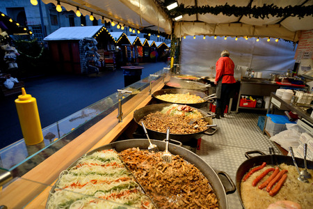 tradespeople: BERLIN - DECEMBER 25: Unidentified people trades food in annual traditional Christmas fair on 25 December 2014 in Berlin, Germany.
