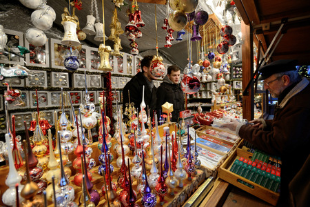 tradespeople: BERLIN - DECEMBER 25: Unidentified people trades Christmas decorations in annual traditional Christmas fair on 25 December 2014 in Berlin, Germany.