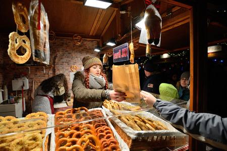 tradespeople: BERLIN - DECEMBER 26: Unidentified people trades food in annual traditional Christmas fair in Alexanderplatz on 26 December 2014 in Berlin, Germany.