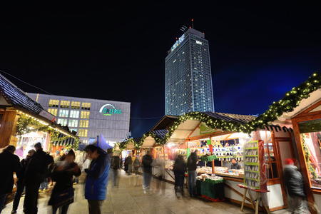 tradespeople: BERLIN - DECEMBER 26: Unidentified people in traditional Christmas fair in Alexanderplatz on 26 December 2014 in Berlin, Germany. Berlin is the capital city of the German Christmas Markets.