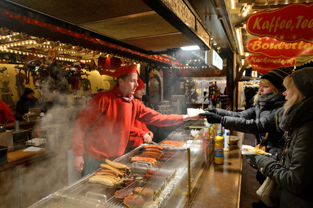 tradespeople: BERLIN - DECEMBER 26: Unidentified people trades food in annual traditional Christmas fair in Charlottenburg (Quarter of Berlin) on 26 December 2014 in Berlin, Germany. Editorial