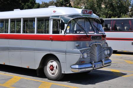 discontinued: VICTORIA, GOZO, MALTA - APR 23 :The legendary and iconic Malta public bus in the Victoria city bus station in Gozo island, Malta April 23, 2011