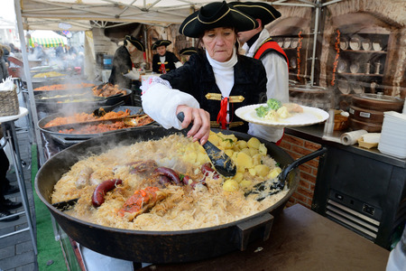 tradespeople: VILNIUS, LITHUANIA - MARCH 6: Unidentified people trade food in annual traditional crafts fair - Kaziuko fair on Mar 6, 2015 in Vilnius, Lithuania Editorial