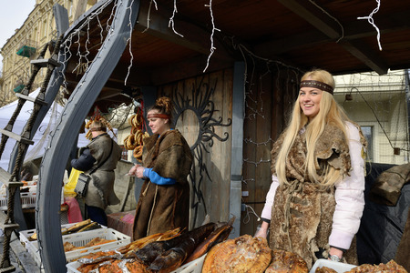 tradespeople: VILNIUS, LITHUANIA - MARCH 6: Unidentified people trade smoked fish in annual traditional crafts fair - Kaziuko fair on Mar 6, 2015 in Vilnius, Lithuania