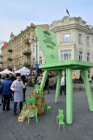 tradespeople: VILNIUS, LITHUANIA - MARCH 6: Unidentified people sell handmade souvenirs from carved wood in annual traditional crafts fair - Kaziuko fair on Mar 6, 2015 in Vilnius, Lithuania Editorial