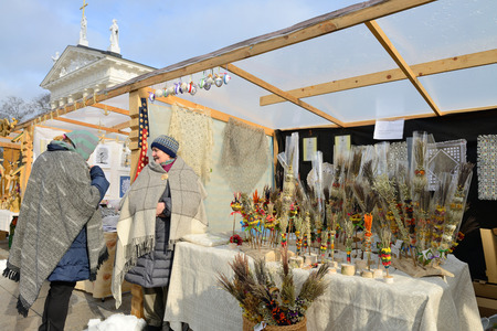 tradespeople: VILNIUS, LITHUANIA - MARCH 6: Unidentified people trade traditional palm bouquets in annual traditional crafts fair - Kaziuko fair on Mar 6, 2015 in Vilnius, Lithuania