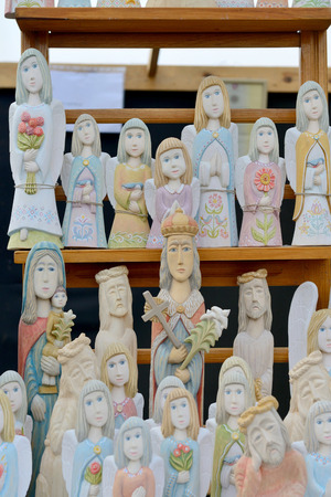 tradespeople: VILNIUS, LITHUANIA - MARCH 6: Traditional hand made wood angels in annual traditional crafts fair - Kaziuko fair on Mar 6, 2015 in Vilnius, Lithuania