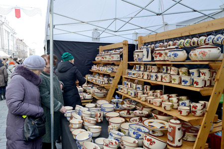 tradespeople: VILNIUS, LITHUANIA - MARCH 6: Unidentified people trade typical lithuanian clay pots in annual traditional crafts fair - Kaziuko fair on Mar 6, 2015 in Vilnius, Lithuania Editorial