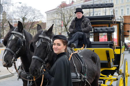 tradespeople: VILNIUS, LITHUANIA - MARCH 6: Unidentified people with horses in annual traditional crafts fair - Kaziuko fair on Mar 6, 2015 in Vilnius, Lithuania Editorial