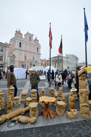 tradespeople: VILNIUS, LITHUANIA - MARCH 7: Unidentified people sell handmade souvenirs from carved wood in annual traditional crafts fair - Kaziuko fair on Mar 7, 2015 in Vilnius, Lithuania
