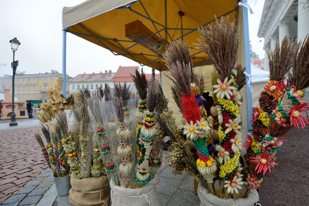 tradespeople: VILNIUS, LITHUANIA - MARCH 7: Unidentified people trade traditional palm bouquets in annual traditional crafts fair - Kaziuko fair on Mar 7, 2015 in Vilnius, Lithuania Editorial