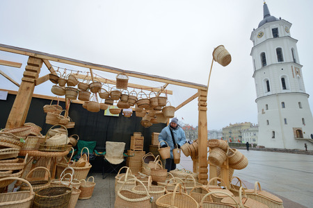 tradespeople: VILNIUS, LITHUANIA - MARCH 7: Unidentified people trades hand made basket in annual traditional crafts fair - Kaziuko fair on Mar 7, 2015 in Vilnius, Lithuania Editorial