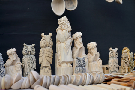 tradespeople: VILNIUS, LITHUANIA - MARCH 8: Traditional hand made wood sculptures in annual traditional crafts fair - Kaziuko fair on Mar 8, 2015 in Vilnius, Lithuania Editorial