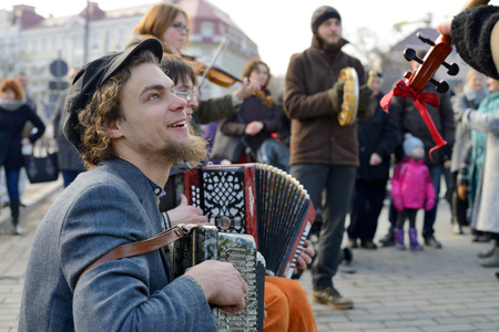 tradespeople: VILNIUS, LITHUANIA - MARCH 8: Unidentified musician in annual traditional crafts fair - Kaziuko fair on Mar 8, 2015 in Vilnius, Lithuania Editorial