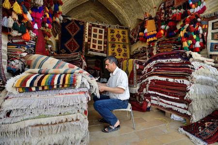 SHIRAZ - APRIL 14: Traditional iranian carpets in a market (Vakil Bazaar) in Shiraz, Iran on April 14, 2015. Vakil Bazaar is the most important tourist attraction in Shiraz, Iran.