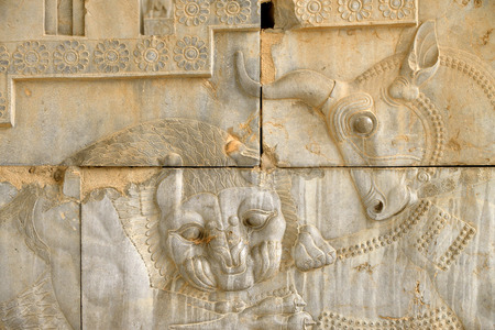 declared: Basrelief of a bull and a lion at the ruins of Persepolis in Iran. UNESCO declared the ruins of Persepolis a World Heritage Site in 1979.