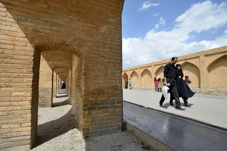 ISFAHAN  APRIL 18: Unknown people on Siosepol bridge in Isfahan Iran on April 18 2015. Siosepol or Siose Bridge is longest bridge on Zayandeh River with the total length of 297.76 metres. Editorial
