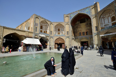 isfahan: ISFAHAN  APRIL 19: Main entrance in to market Bazaar in Isfahan Iran on April 19 2015. Bazaar of Isfahan is the most important tourist attraction in Isfahan Iran. Editorial