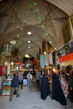 isfahan: ISFAHAN  APRIL 19: Main street of market Bazaar in Isfahan Iran on April 19 2015. Bazaar of Isfahan is the most important tourist attraction in Isfahan Iran.