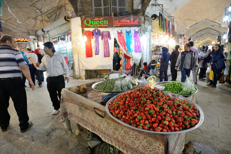 isfahan: ISFAHAN  APRIL 19: Unknown man trades fruits in a market Isfahan Bazaar in Isfahan Iran on April 19 2015. Bazaar is the most important tourist attraction in Isfahan Iran. Editorial