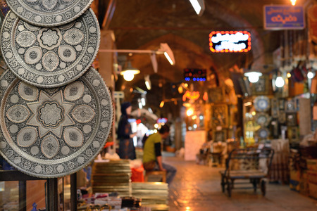 isfahan: ISFAHAN  APRIL 19: Traditional iranian souvenirs in market Bazaar in Isfahan Iran on April 19 2015. Bazaar of Isfahan is the most important tourist attraction in Isfahan Iran.