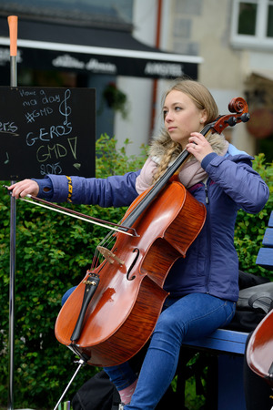 violoncello: VILNIUS LITHUANIA  MAY 16: Unidentified musician plays violoncello in Street music day on May 16 2015 in Vilnius. Its a most popular event on May in Vilnius Lithuania