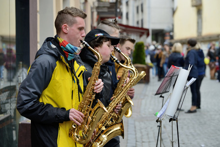 play popular: VILNIUS LITHUANIA  MAY 16: Unidentified musicians play Saxophone in Street music day on May 16 2015 in Vilnius. Its a most popular event on May in Vilnius Lithuania