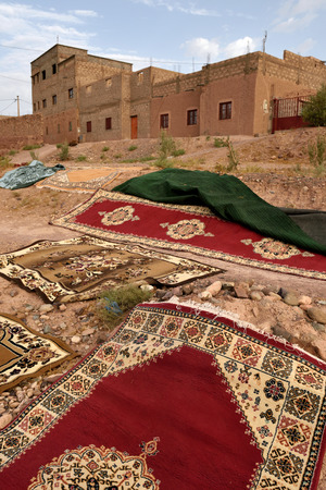 berber: MOROCCO - AUGUST 01: Traditional berber carpets drying in open air in Morocco, August 01, 2015. Morocco is one of the most popular tourist place in North Africa. Editorial