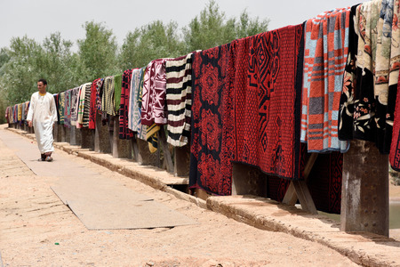 berber: MOROCCO - AUGUST 02: Traditional berber carpets drying in open air in Morocco, August 02, 2015. Morocco is one of the most popular tourist place in North Africa.