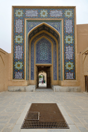 YAZD - APRIL 17: Back entrance of Jame Mosque in Yazd, southern Iran on April 17, 2015. The Jame Mosque of Yazd is the grand, congregational mosque of Yazd city, within the Yazd Province of Iran Editorial
