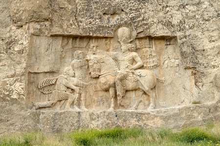 fars: Rock relief cuted into the cliff. Naqsh-e Rustam, an ancient necropolis in Pars Province, Iran