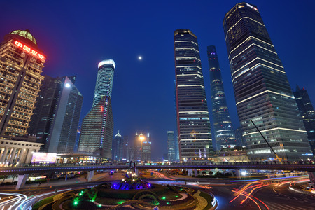 pudong district: SHANGHAI, CHINA - MARCH 20: Pudong district night view on March 20, 2016 in Shanghai, China. Pudong is a district of Shanghai, located east of the Huangpu River.