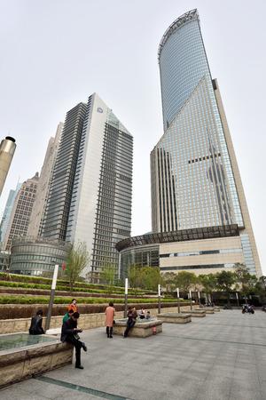 pudong district: SHANGHAI, CHINA - MARCH 20: Pudong district skyscrapers on March 20, 2016 in Shanghai, China. Pudong is a district of Shanghai, located east of the Huangpu River.