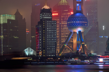 pudong district: SHANGHAI, CHINA - MARCH 19: Pudong district night view from The Bund waterfront area on March 19, 2016 in Shanghai, China. Pudong is a district of Shanghai, located east of the Huangpu River. Editorial